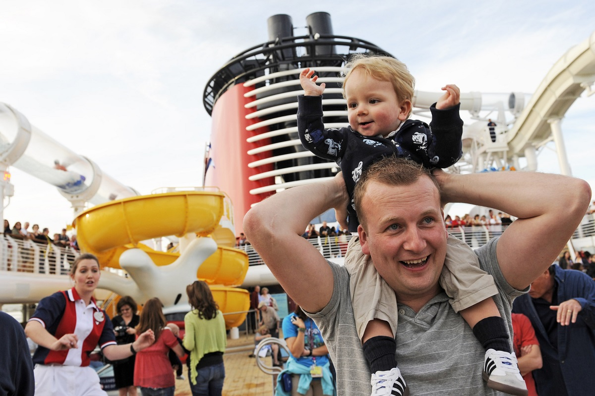 Toddler on dad's shoulders on Disney cruise