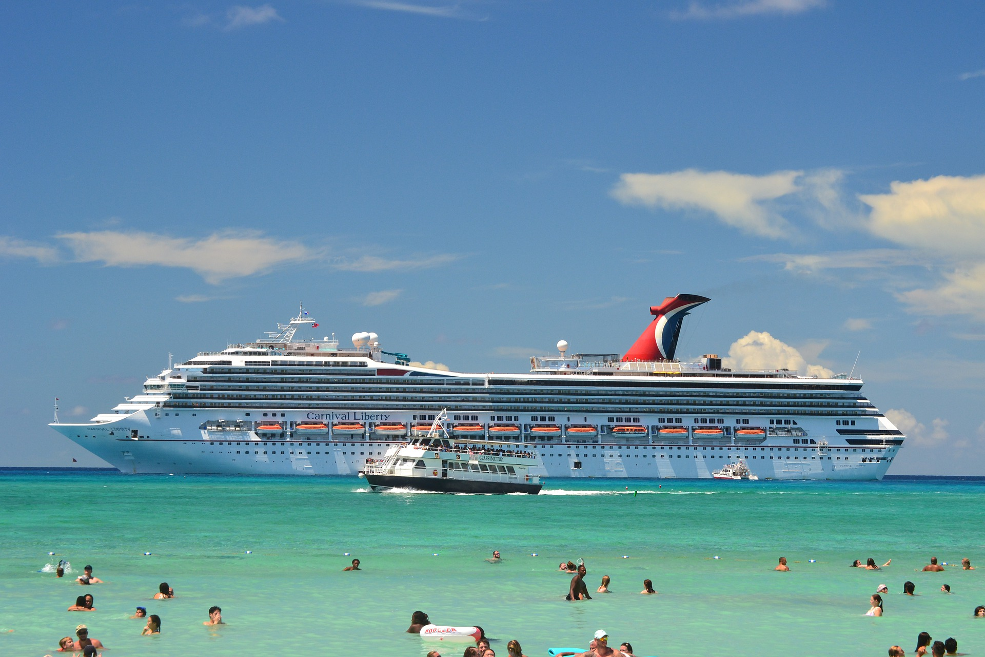 Carnival Liberty cruise ship off the coast of a beach (source: asram02, Pixabay)