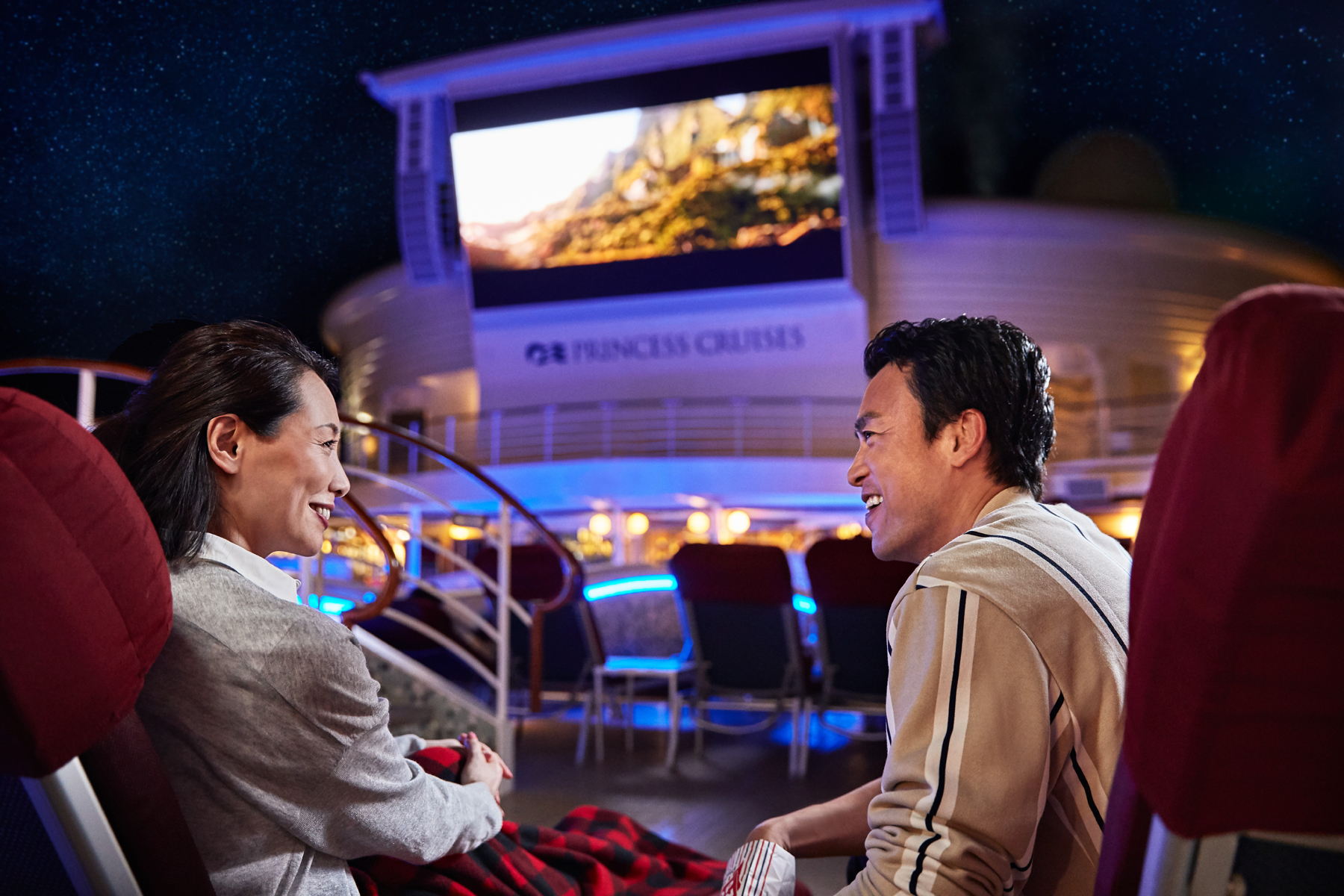 Couple watching Movies Under the Stars MUTS on Princess cruise ship (source: Princess Cruises)
