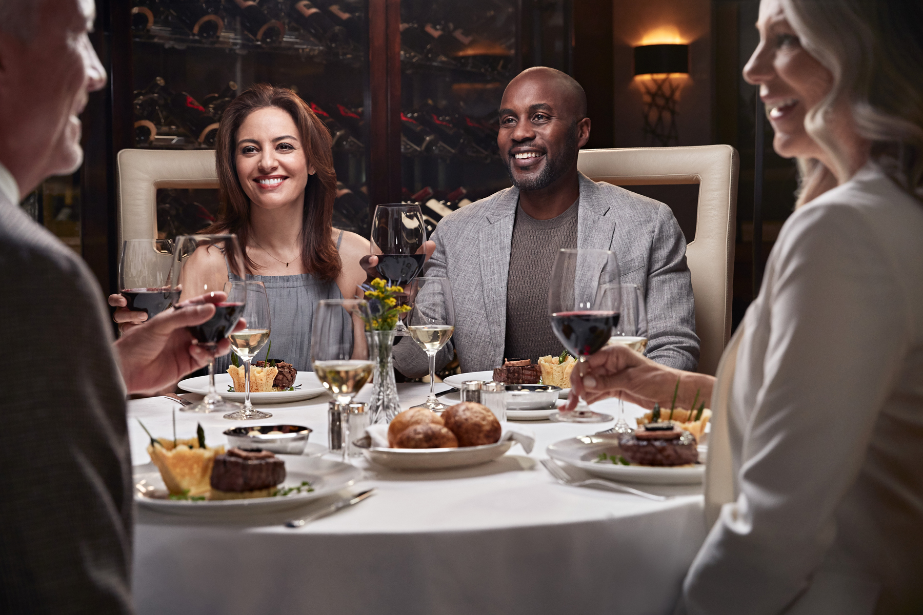 A group eating in the Concerto dining room on Grand Princess (source: Princess Cruises)