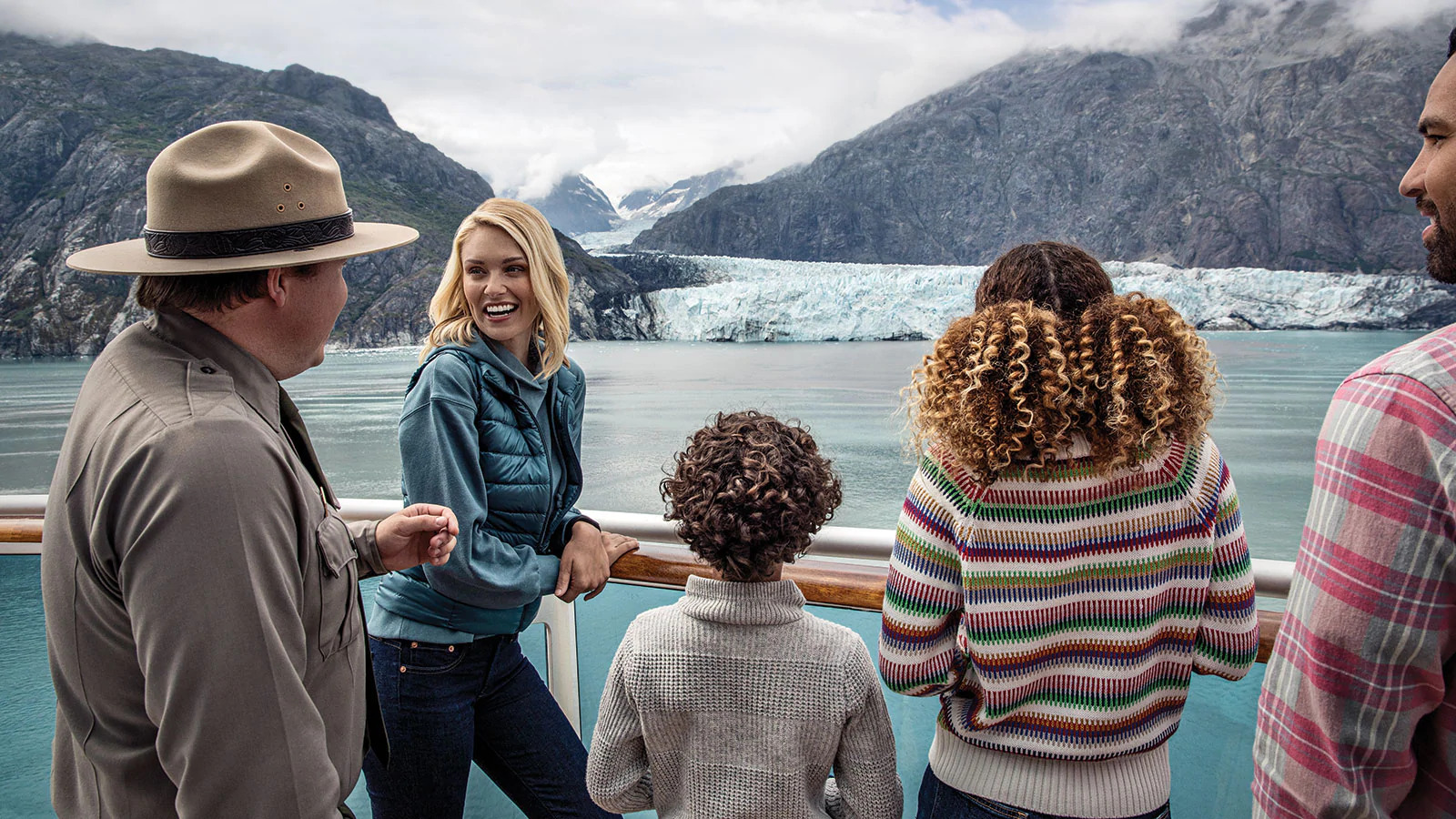 Family watching glaciers