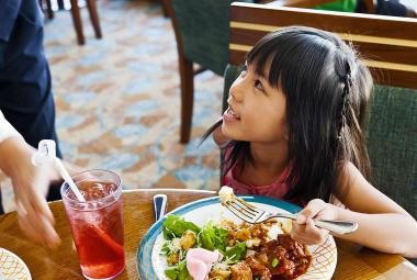 Girl eating at Windjammer buffet on Royal Caribbean